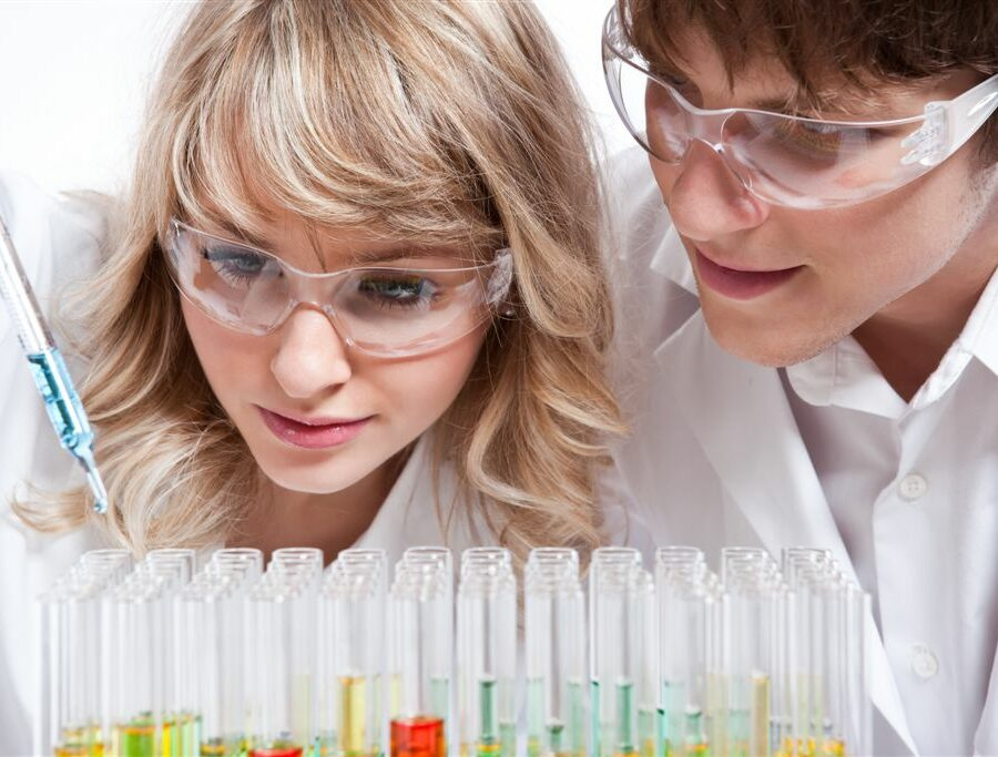 A shot of a male and female caucasian scientists